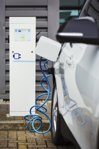 electric-car-being-charged-with-a-cable-connected--EEY3EZK